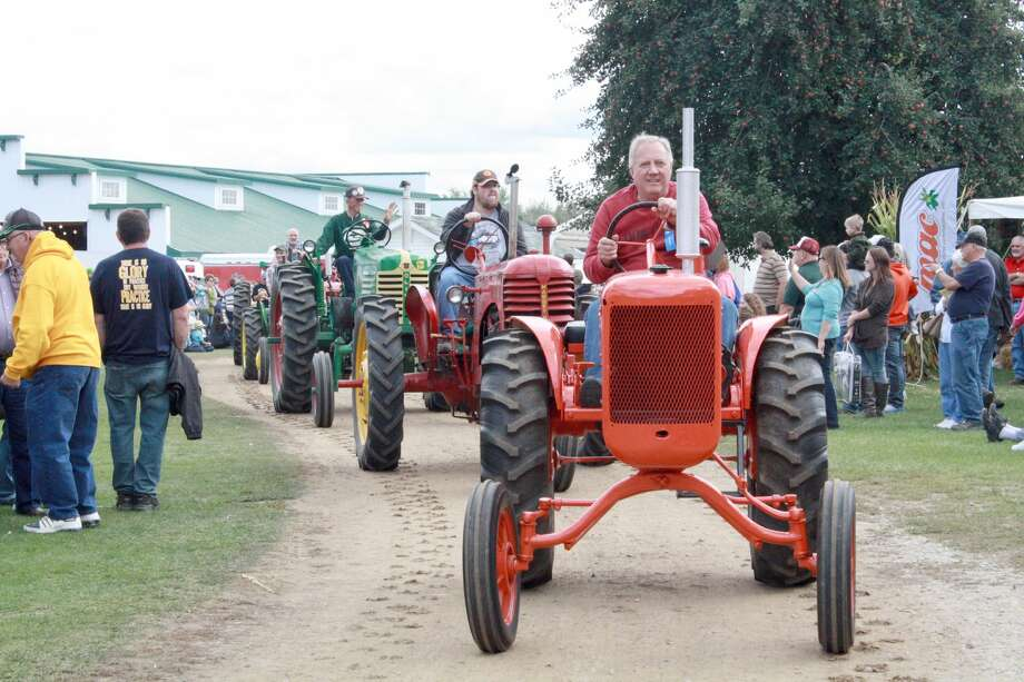 Vintage tractors of all sizes and types were featured in the annual parade at the Octagon Barn this weekend. Photo: Rich Harp/For The Tribune