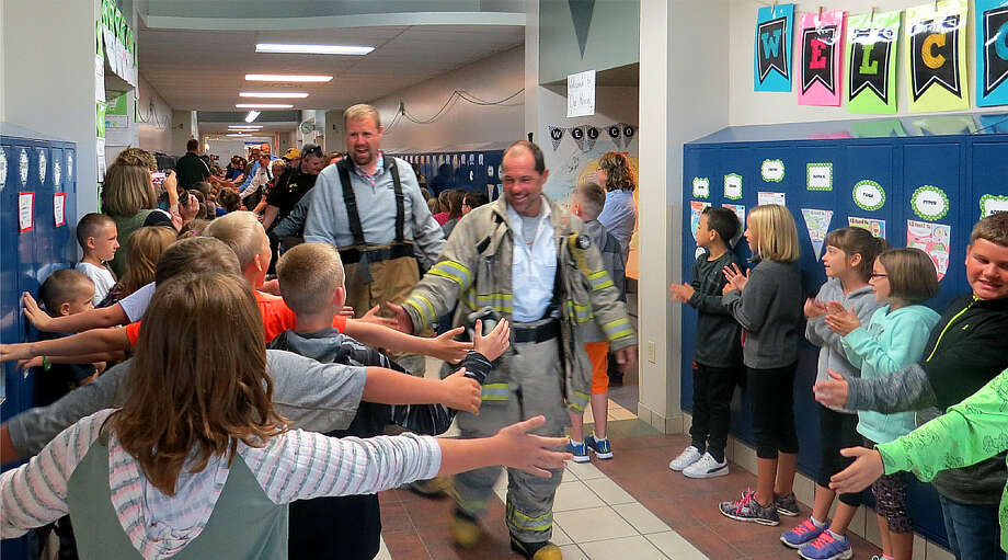 Roughly 20 heroes visited Laker Elementary on Sept. 11 for the Hallway of Heroes event. First, the heroes visited classrooms to talk about their hero jobs and they answered questions. Then, students and staff lined the hallways as the heroes walked between them, sharing hundreds of high-fives along the way. The heroes included local police, firefighters, EMTs, nurses and members of the military. The event is offered through a 9/11 National Day of Service Grant from the Michigan Community Service Commission. As part of this event, the school also purchased $500 worth of children's books that focus on community service and heroes. Photo: Submitted Photo