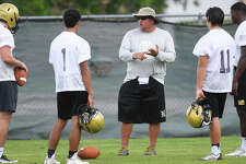 Nederland's new head coach Monte Barrow watches players during Monday's practice at the Bulldog's practice field. Photo taken Monday, August 07, 2017 Guiseppe Barranco/The Enterprise