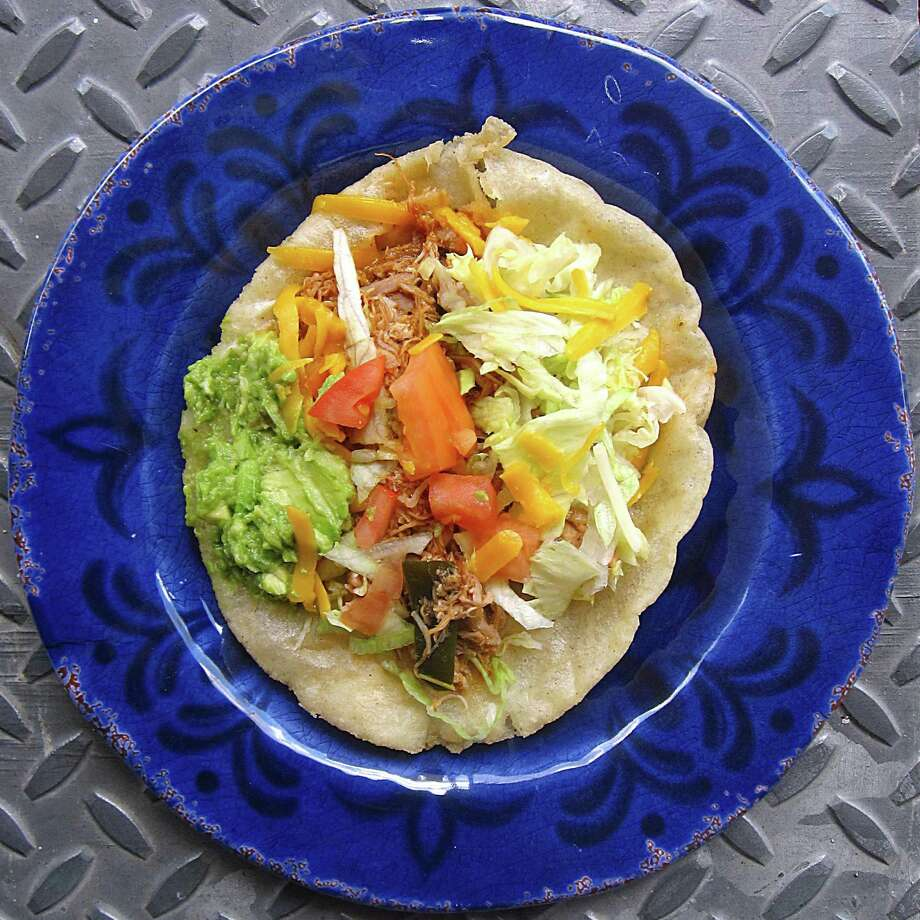 Chicken puffy taco from Lula's Mexican Cafe. Photo: Mike Sutter /San Antonio Express-News