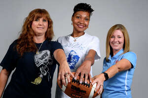 Frances Thompson, Karen Taylor and Mandy Babin support their husbands, who are head football coaches at area schools. Thompson's husband coaches West Orange-Stark, Taylor's at Ozen and Babin's leads Lumberton.  Photo taken Saturday 7/15/17 Ryan Pelham/The Enterprise