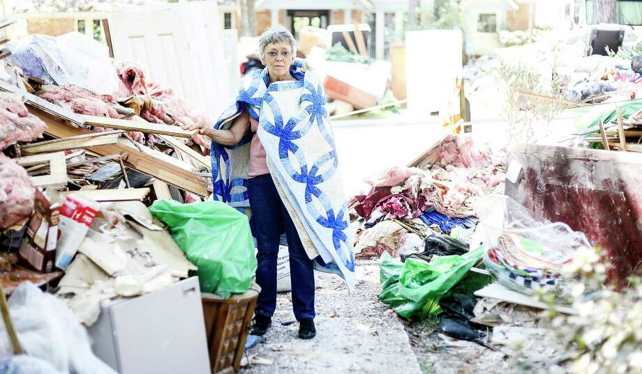 Carolyn Bennett, 70, holds onto a quilt she saved from Tropical Storm Harvey as her home started to flood. Photographed on Saturday, Sept. 9, 2017. People hold onto items that were important for them to keep out of flood waters on Saturday, Sept. 9, 2017, in Kingwood.  ( Elizabeth Conley / Houston Chronicle ) Photo: Elizabeth Conley, Staff / © 2017 Houston Chronicle