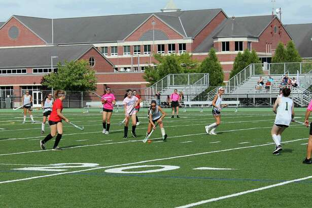 The New Milford Green Wave field hockey team during a recent scrimmage.