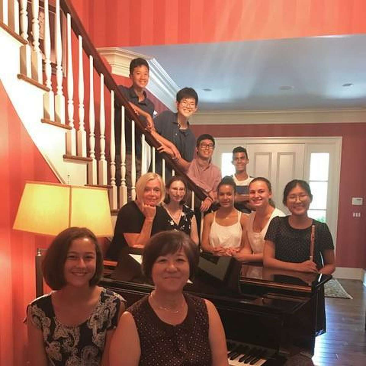 """Advanced students of Wilton pianist Kyung Hee Cho who will perform at the 11th annual """"Playing By Heart"""" benefit concert on Saturday, Sept. 16."""