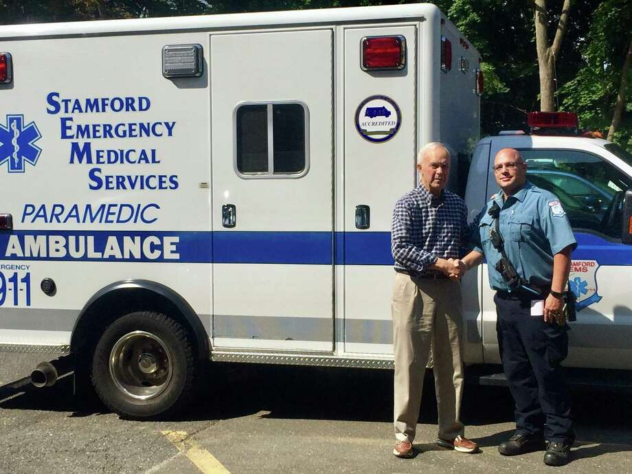 Shippan resident John Bonora, left, thanks Stamford EMS paramedic Andy Konspore, who helped save Bonora's life when he experienced a life-threatening cardiac emergency last month. Photo: Photo Contributed By Stamford EMS / Stamford Advocate  contributed