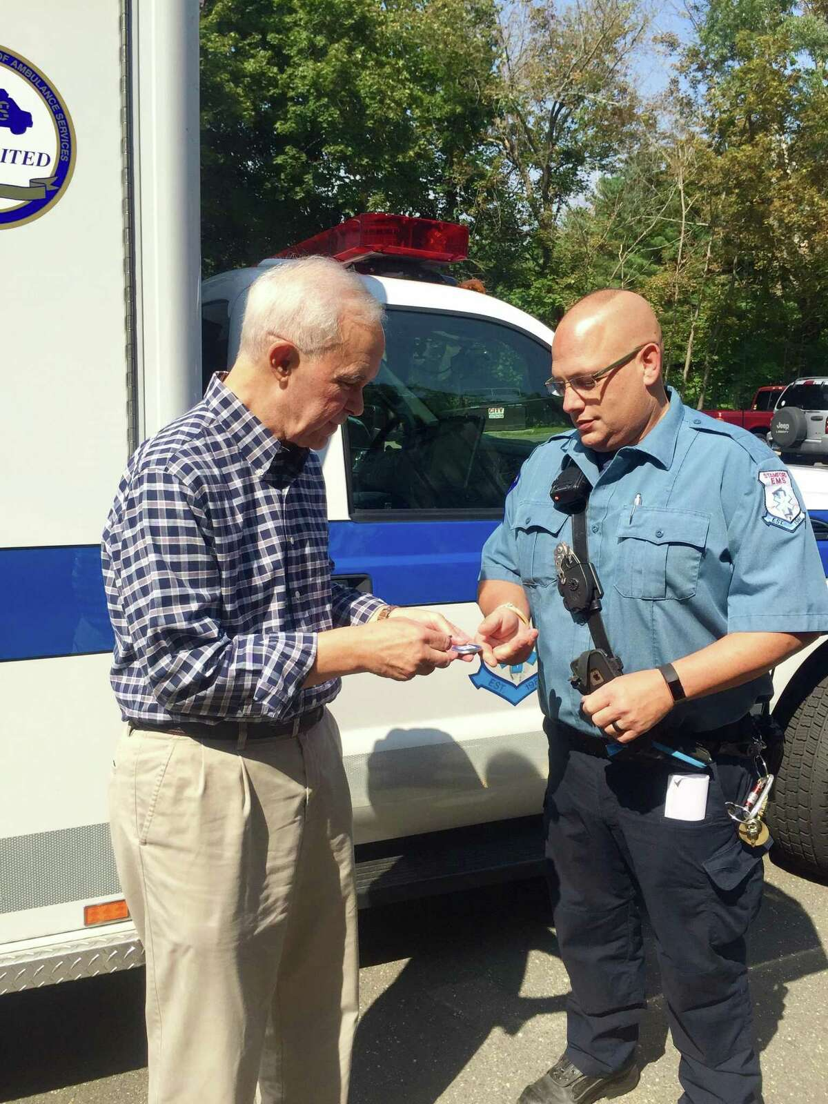 Shippan resident John Bonora, left, thanks Stamford EMS paramedic Andy Konspore, who helped save Bonora's life when he experienced a life-threatening cardiac emergency last month.