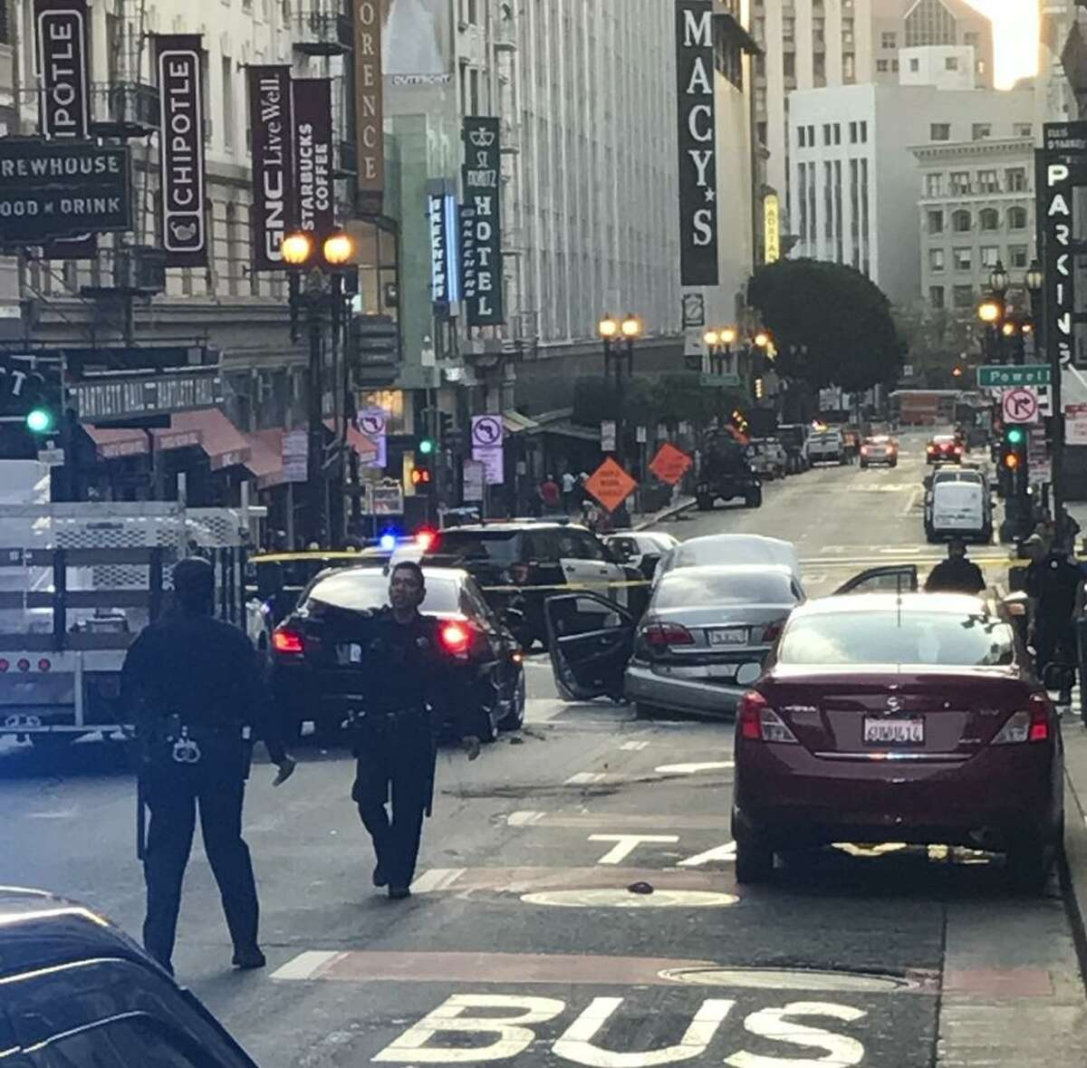 S.F. police investigate a shooting on O'Farrell Street, between Cyril Magnin and Mason streets, that led to a three-car crash.