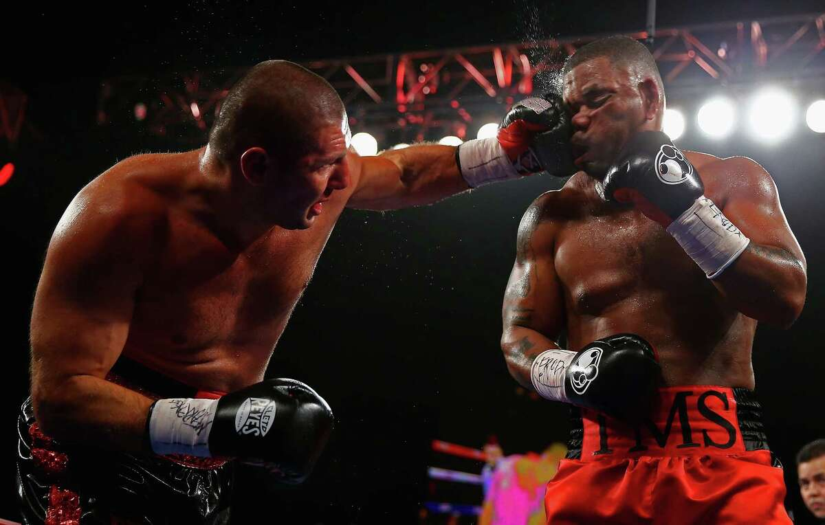 Mike Perez punches Magomed Abdusalamov during their Heavyweight fight at The Theater at Madison Square Garden on November 2, 2013, in New York City. (Photo by Al Bello/Getty Images)