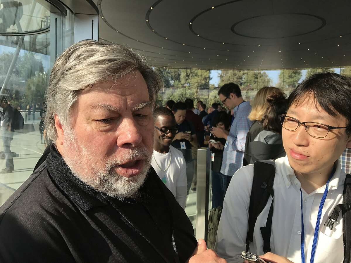 Apple co-founder Steve Wozniak speaks to reporters outside Steve Jobs Theater at Apple Park in Cupertino Tuesday.