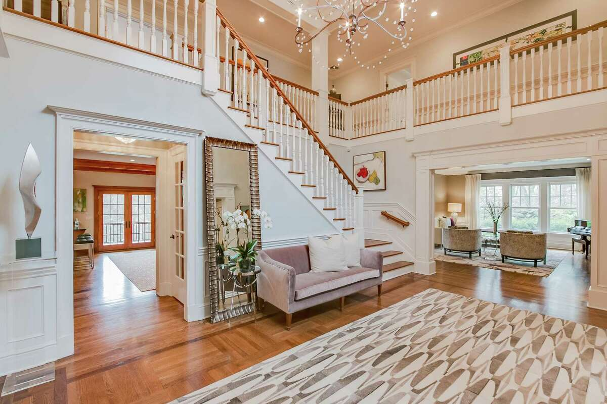 The sizable two-story foyer has a remodeled powder room with lights that turn on automatically as someone enters the room.