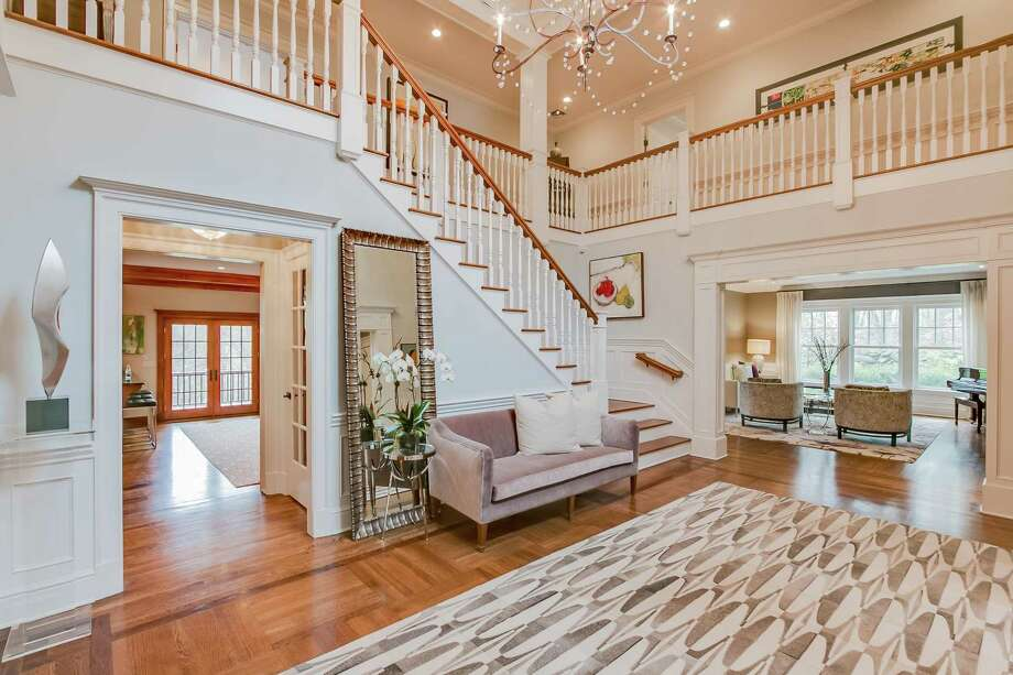 The sizable two-story foyer has a remodeled powder room with lights that turn on automatically as someone enters the room. Photo: Dennis R Dimick / / All Rights Reserved