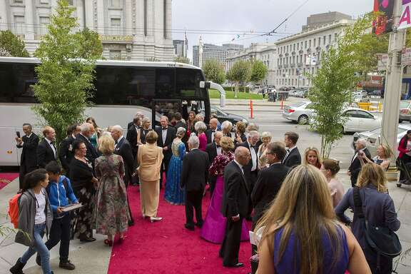 Bernard Osher and his 90 guests -- helping him celebrate his 90th birthday -- arrive by bus at the War Memorial Opera House during the Opera Ball on Friday, Sept. 8, 2017, in San Francisco, Calif.