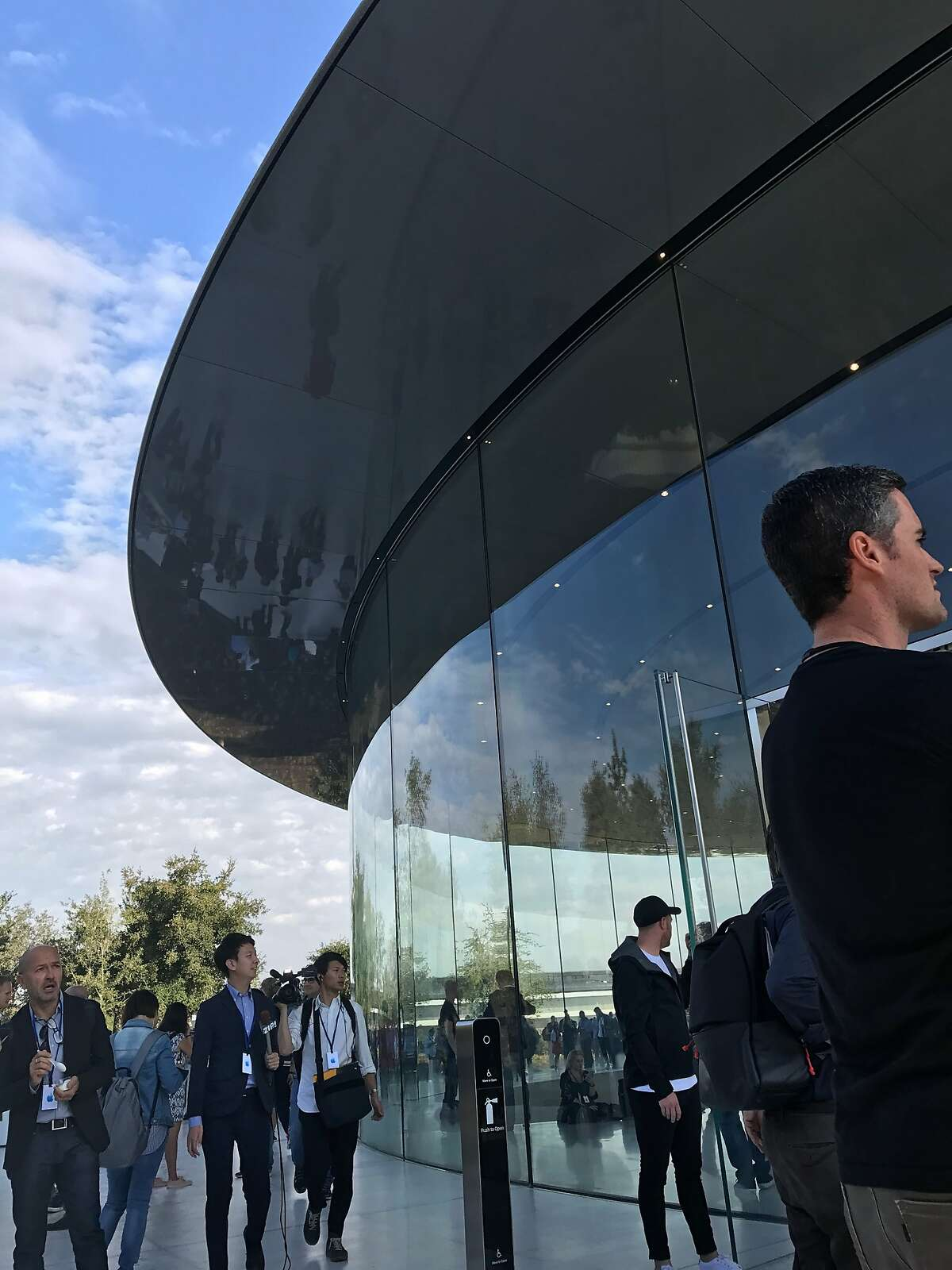 Scenes outside the Steve Jobs Theater on the Apple Park headquarters campus in Cupertino on Tuesday before the company reveals its latest iPhones and other products
