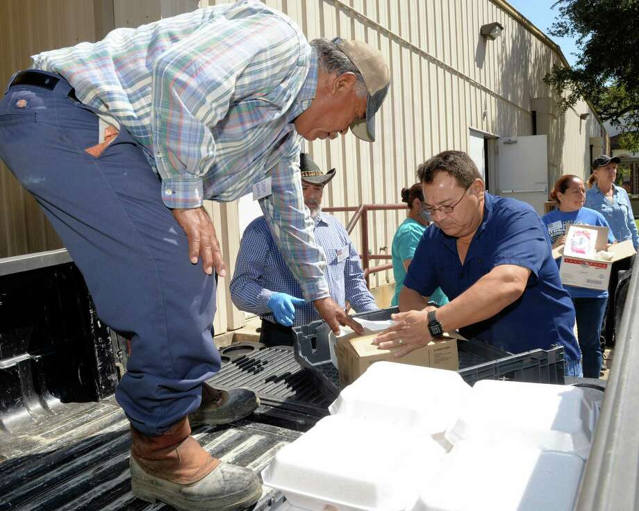 At Our Lady of Guadalupe Church in Rosenberg, TX, volunteers prepare to distribute hot meals to flood victims on September 7, 2017. Photo: Craig Moseley, Staff / ©2017 Houston Chronicle