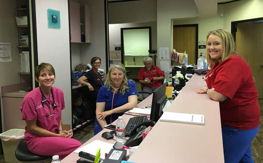 Christ Clinic of Katy is offering free medical services after Harvey. In front, from left, are: Amy Huston and Holly Goshu, both nurse practitioners, and Taylor Oakes, a registered nurse and volunteer from Tennessee. In back are: Jean Andersson-Swayze and Dr. Gary Nichols, both of Heart to Heart International. Photo: Karen Zurawski