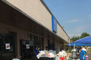 After Hurricane Harvey, Katy Christian Ministries set up tables outside to serve people.