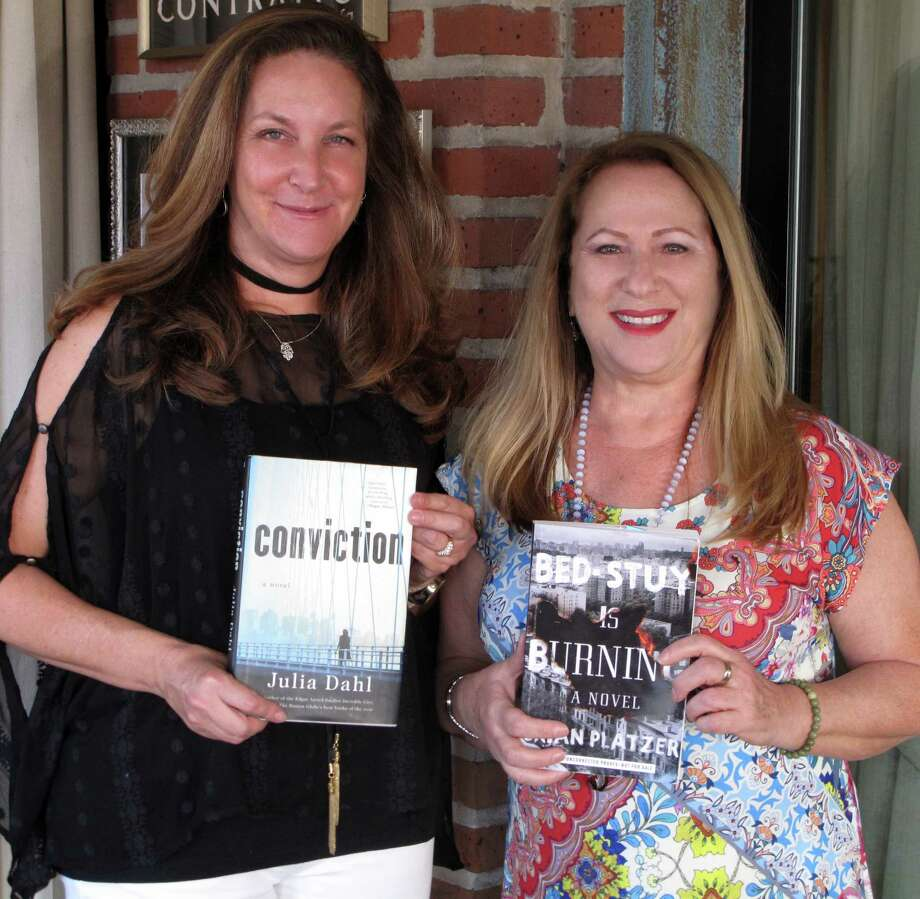 Lori Farris and Stefani Twyford hold this year's choices for the Community Read event at the J's Ann and Stephen Kaufman Jewish Book & Arts Festival, October 28 – November 12, 2017. Photo: Evelyn Rubenstein JCC