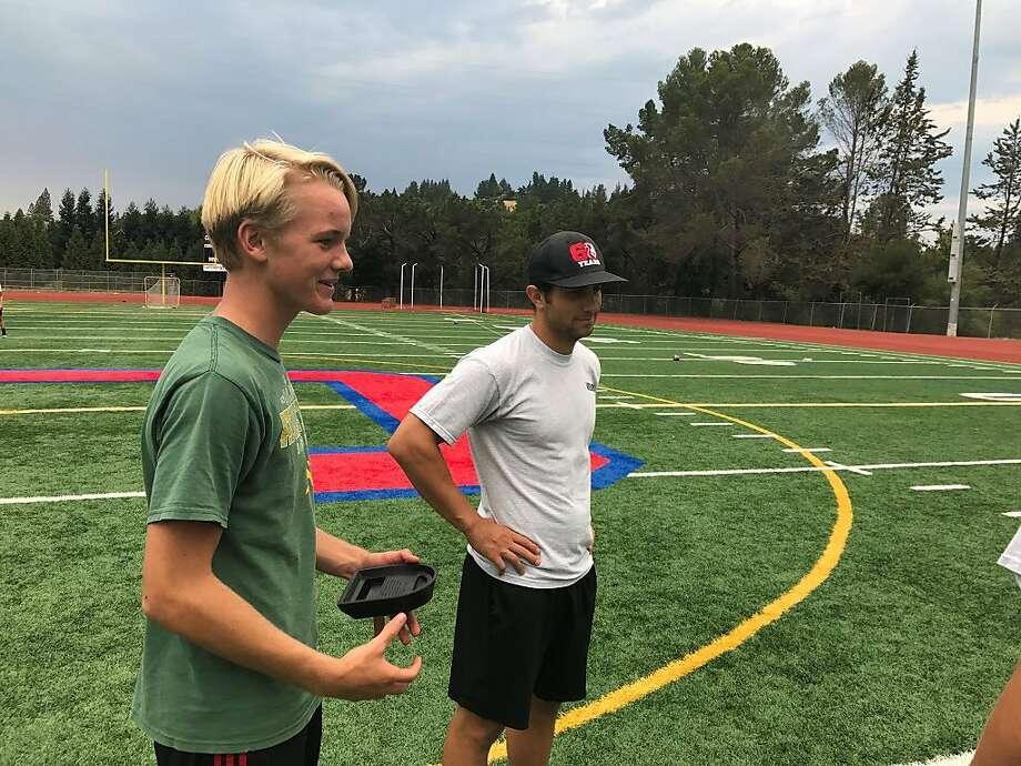 Raiders kicker Giorgio Tavecchio (right) chats with Campolindo junior Riley Breul during Monday's practice at the school. Photo: Ron Kroichick