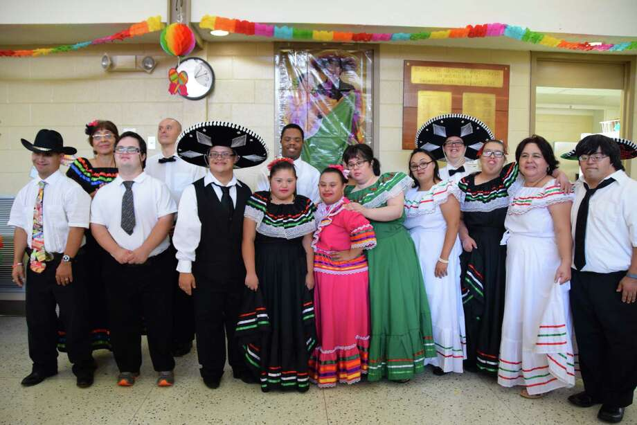 Students with the Houston Down Syndrome Academy are putting the finishing touches on their annual Fiesta Luncheon, slated for noon Saturday, Sept. 16. Photo: Submitted Photo