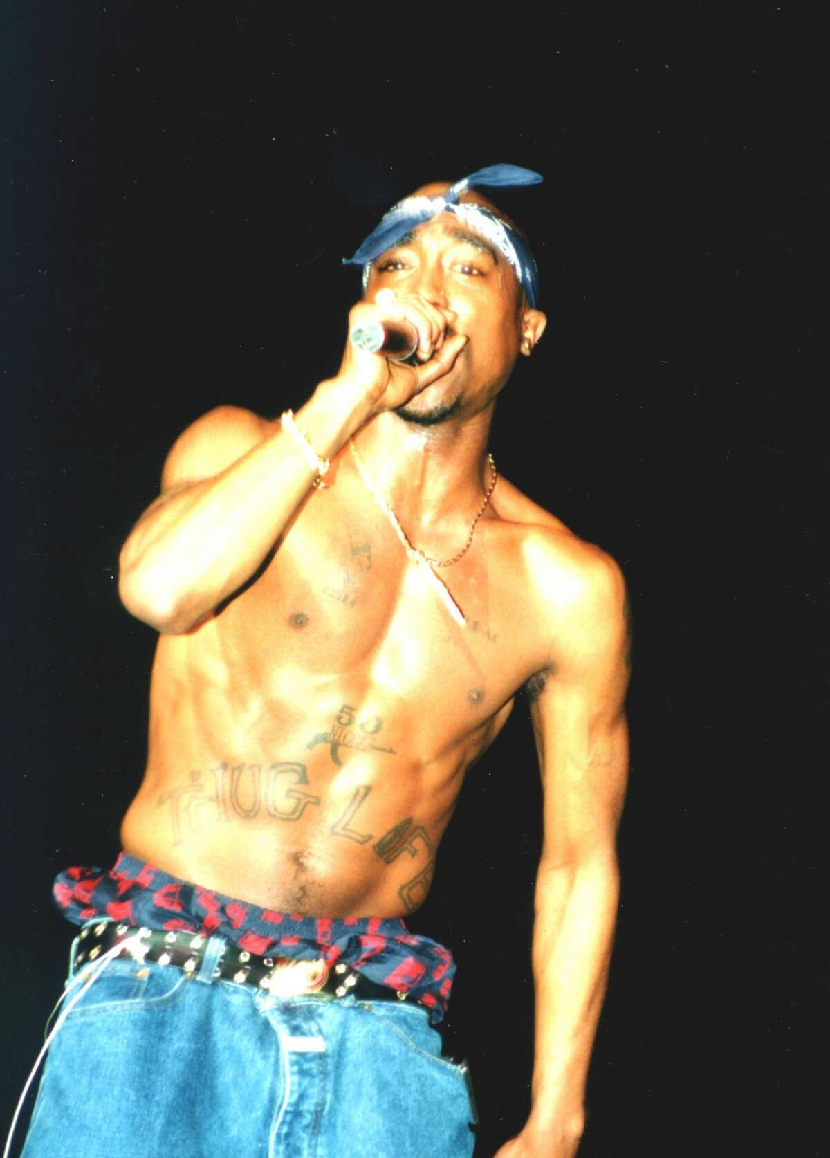 CHICAGO - MARCH 1994: Rapper Tupac Shakur performs onstage in 1994 in Chicago, Illinois.