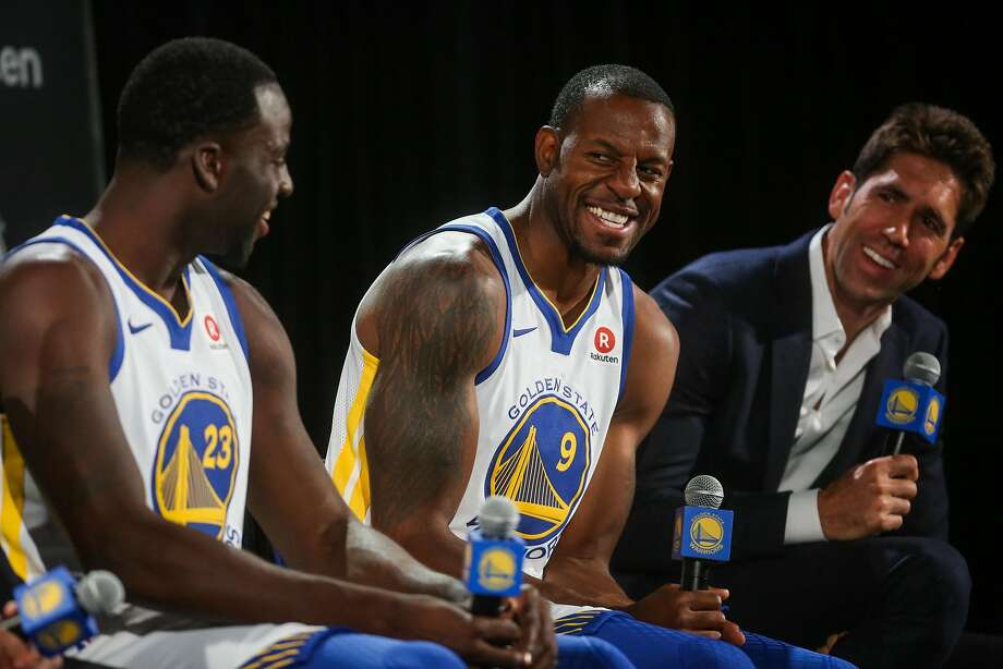 Draymond Green, Andre Iguodala and general manager Bob Myers laugh during a press conference. Photo: Gabrielle Lurie, The Chronicle