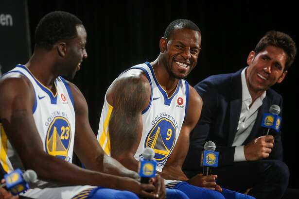 (l-r) Draymond Green, Andre Iguodala and general manager Bob Myers laugh during a press conference to annouce a jersey sponsorship deal between Rakuten and the Golden State Warriors in Oakland, Calif., on Tuesday, Sept. 12, 2017.
