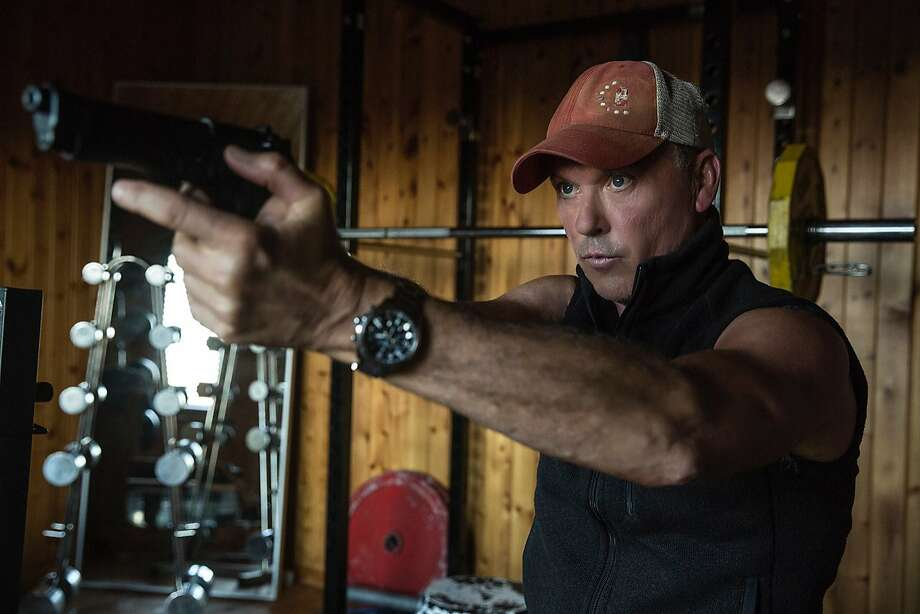 "Michael Keaton plays psycho killer Stan Hurley, capable of killing with his bare hands, in a scene from ""American Assassin."" Photo: Christian Black, Associated Press"