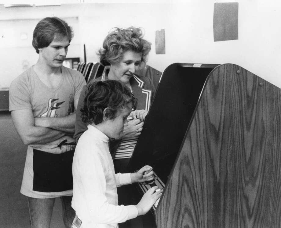 Rick Enszer, left, and Jill and Jon Tessin at The Corridor arcade. June 1982 Photo: Daily News File Photo