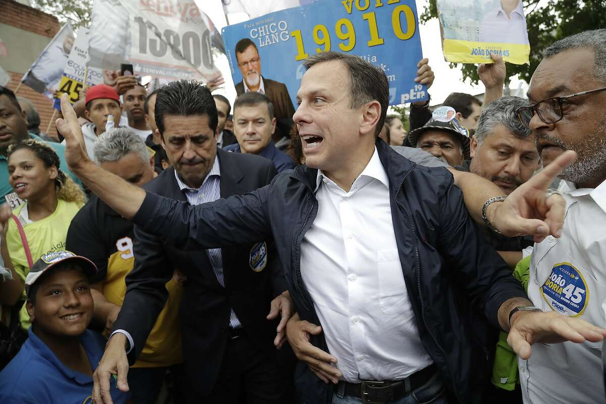 In this Sept. 30, 2016 file photo, Joao Doria, mayoral candidate with the Brazilian Social Democracy Party, greets supporters during a campaign rally in Sao Paulo, Brazil. Doria is eyeing a run for the 2018 presidential election. (AP Photo/Andre Penner, File)