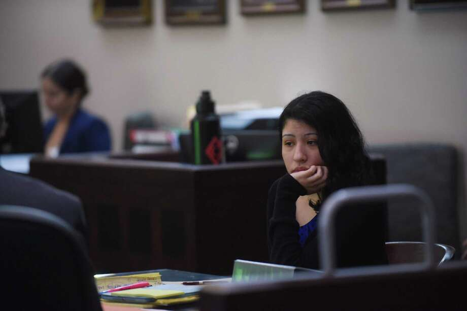 Antoinette Martinez, who is accused in the 2014 deaths of two men who were lured with the promise of sex to her apartment and then robbed and killed, sits in 175th District Court during opening statements on Tuesday, Sept. 12, 2017. Photo: Billy Calzada, Staff / San Antonio Express-News / San Antonio Express-News