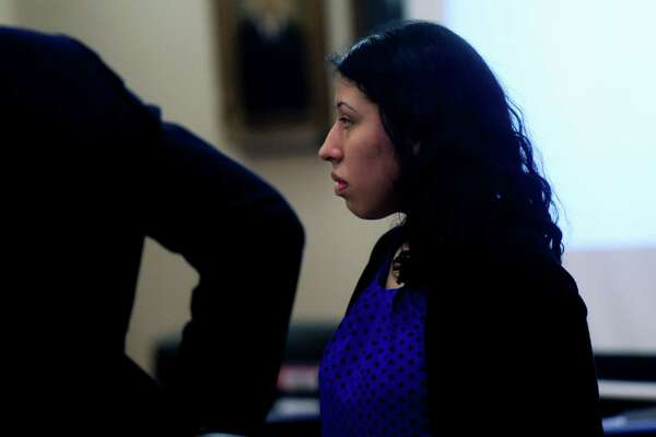 Antoinette Martinez, who is accused in the 2014 deaths of two men who were lured with the promise of sex to her apartment and then robbed and killed, stands in 175th District Court during opening statements on Tuesday, Sept. 12, 2017.