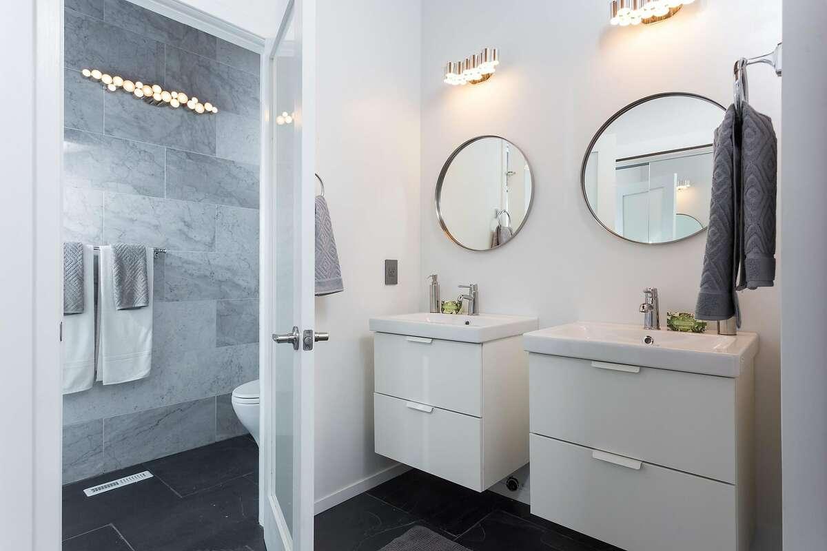 This bathroom offers a pair of floating vanities.