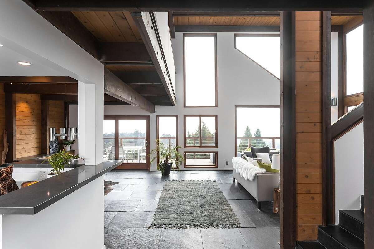 The great room features a double-height ceiling in the living area.