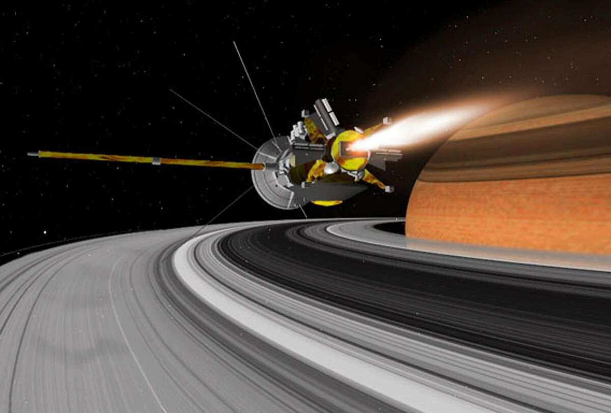 In this artist's conception, NASA's $3.3 billion spacecraft, the Cassini Orbiter, nears the rings of Saturn. Cassini is nearing the end of it's seven-year voyage to Saturn, only to begin an intensive study of the second-largest planet, its rings and the stable of moons that orbit it. The spacecraft is on schedule to enter orbit around Saturn on June 30. (AP Photo/NASA, JPL, Space Science Institute)
