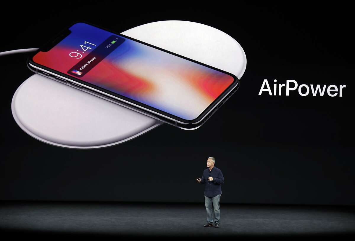 Phil Schiller, Apple's senior vice president of worldwide marketing, discusses features of the new AirPower product at the Steve Jobs Theater on the new Apple campus on Tuesday, Sept. 12, 2017, in Cupertino, Calif. (AP Photo/Marcio Jose Sanchez)
