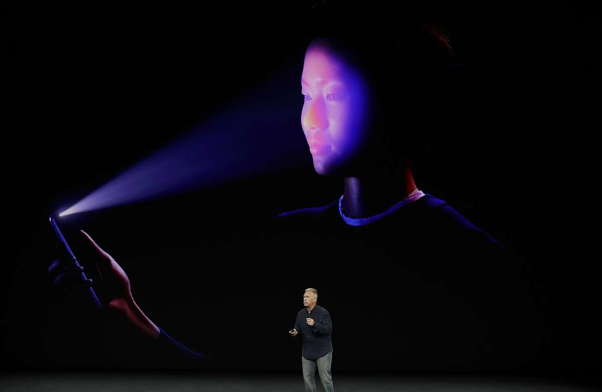 Phil Schiller, Apple's senior vice president of worldwide marketing, describes how the Face ID feature of the new iPhone X works at the Steve Jobs Theater on the new Apple campus on Tuesday, Sept. 12, 2017, in Cupertino, Calif. (AP Photo/Marcio Jose Sanchez)