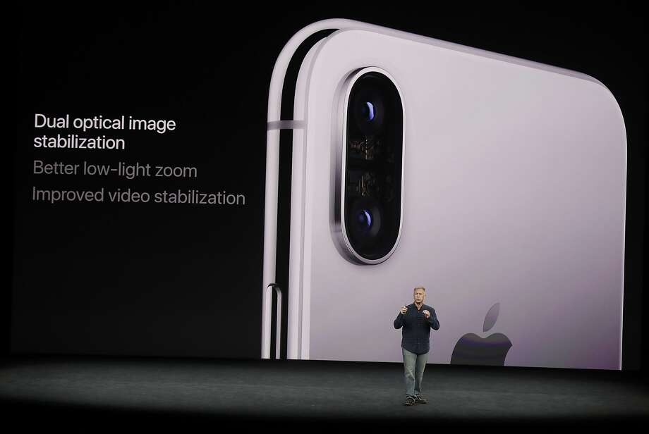 Phil Schiller, Apple's senior vice president of worldwide marketing, discusses features of the new iPhone X at the Steve Jobs Theater on the new Apple campus on Tuesday, Sept. 12, 2017, in Cupertino, Calif. (AP Photo/Marcio Jose Sanchez) Photo: Marcio Jose Sanchez, Associated Press