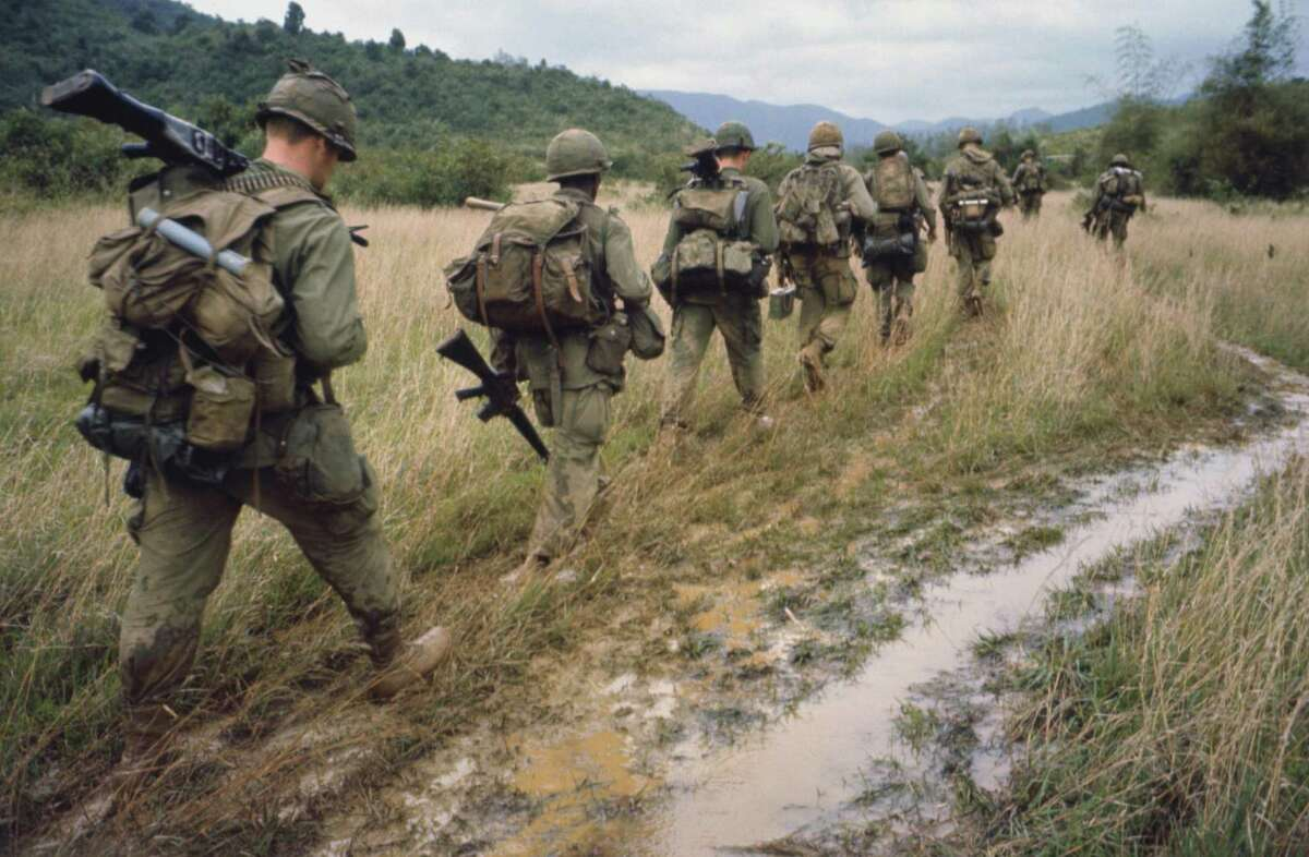 """Soldiers on patrol during the Vietnam War. Documentarians Ken Burns and Lynn Novick have created a 10-part film, """"The Vietnam War,"""" premiering Sunday, Sept 17, on PBS."""
