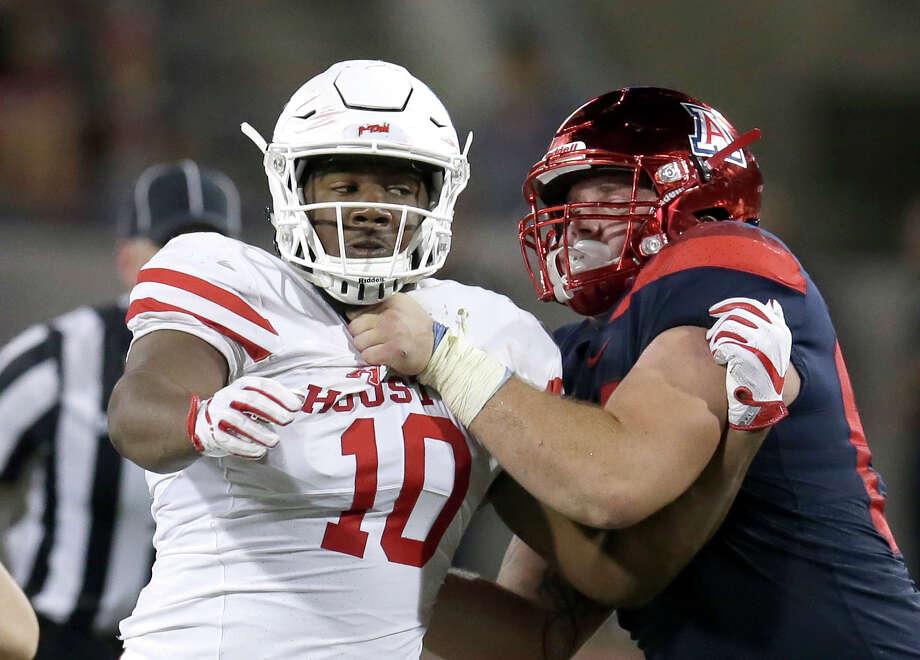 Houston defensive tackle Ed Oliver (10) in the second half during an NCAA college football game against Arizona, Saturday, Sept. 9, 2017, in Tucson, Ariz. Houston defeated Arizona 19-16. (AP Photo/Rick Scuteri) Photo: Rick Scuteri, FRE / FR157181 AP