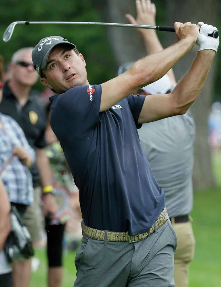 FILE - In this May 28, 2017, file photo, Kevin Kisner watches his approach shot on the 18th hole during the Dean & DeLuca Invitational golf tournament at Colonial Country Club in Fort Worth, Texas. Kevin Kisner began to appreciate the value of playing in the Presidents Cup two months before the matches even started. All because of a text message. (AP Photo/LM Otero, File) Photo: LM Otero, STF / Copyright 2017 The Associated Press. All rights reserved.