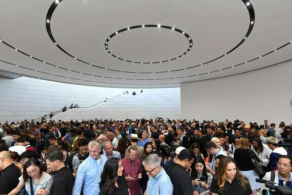 People try out new Apple products during a media event at Apple's new headquarters in Cupertino, California on September 12, 2017.  / AFP PHOTO / Josh EdelsonJOSH EDELSON/AFP/Getty Images