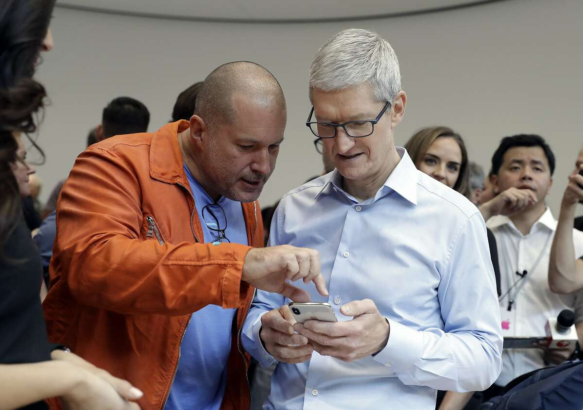 Apple CEO Tim Cook, right, and Jonathan Ive, Chief Design Officer shows the new iPhone X in the showroom after the new product announcement at the Steve Jobs Theater on the new Apple campus on Tuesday, Sept. 12, 2017 in Cupertino.