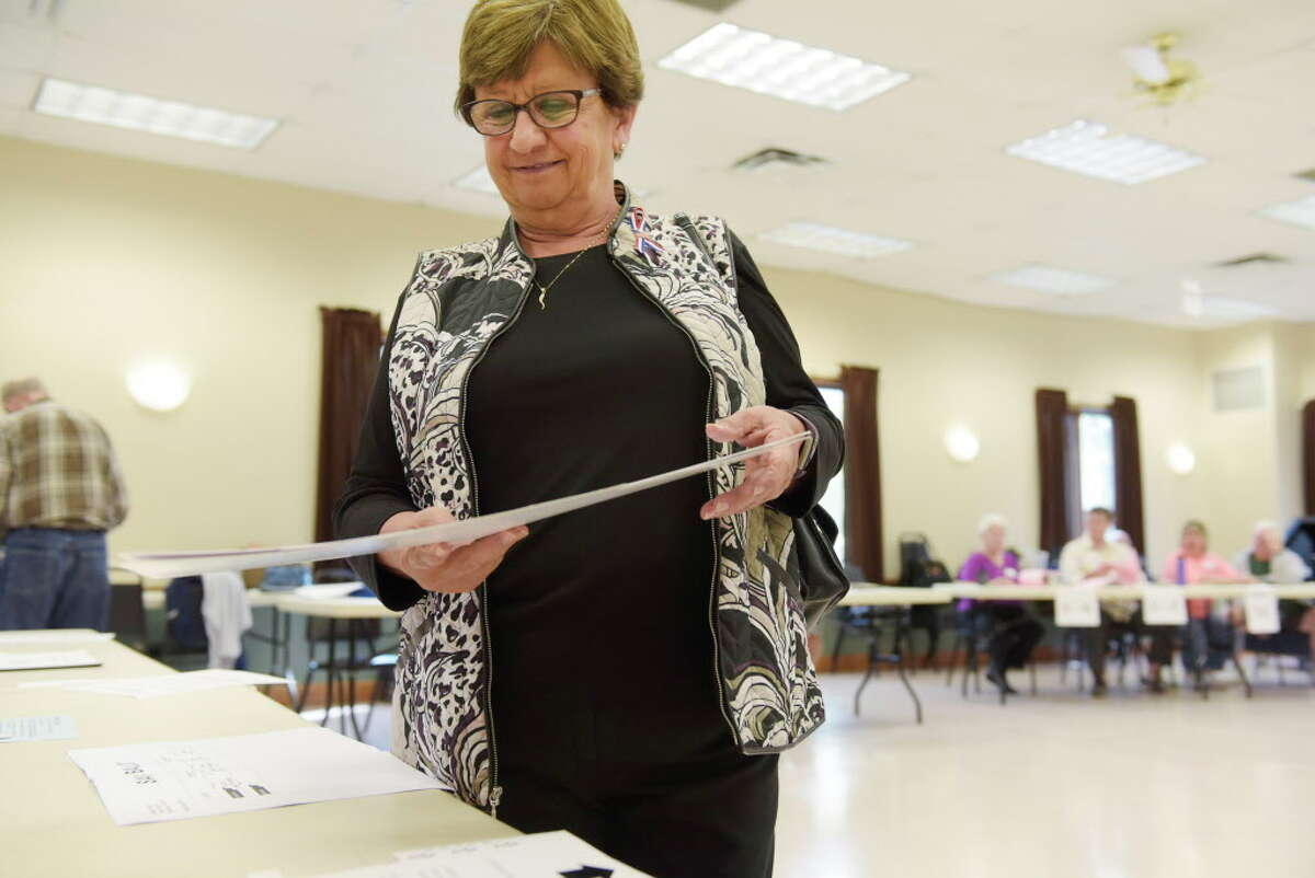 Milton town Councilwoman Barbara Kerr receives her ballot as she votes at the Milton Community Center on Tuesday, Sept. 12, 2017, in Milton, N.Y. (Paul Buckowski / Times Union)