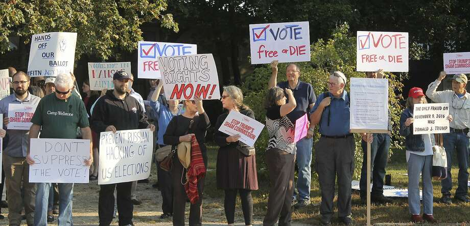 """Protesters gather on Tuesday, Sept. 12, 2017, at Saint Anselm College in Manchester, N.H., ahead of a daylong meeting of the Trump administration's election integrity commission. They argue the commission, which is tasked with investigating voter fraud, is a sham. Signs reading """"Vote Free or Die"""" played off New Hampshire's motto: """"Live Free or Die."""" Photo: Holly Ramer, Associated Press"""