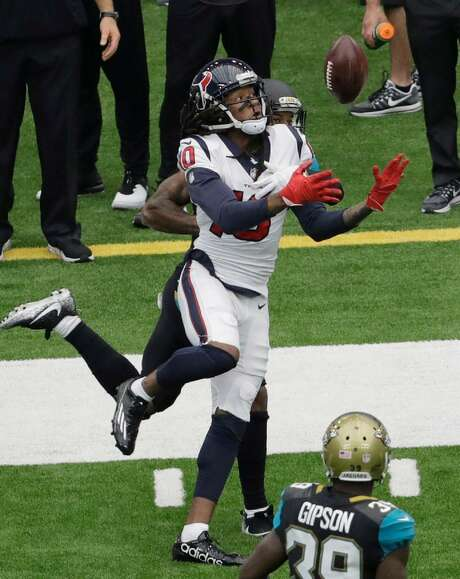 Houston Texans wide receiver DeAndre Hopkins (10) bobbles a pass as Jacksonville Jaguars cornerback A.J. Bouye (21) defends the play during the first half of an NFL football game Sunday, Sept. 10, 2017, in Houston. Photo: Eric Gay /AP Photo