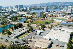 Buildings line the Peralta Community College District offices, one of the sites under consideration for a new Oakland Athletics stadium, on Sunday, May 28, 2017, in Oakland, Calif.