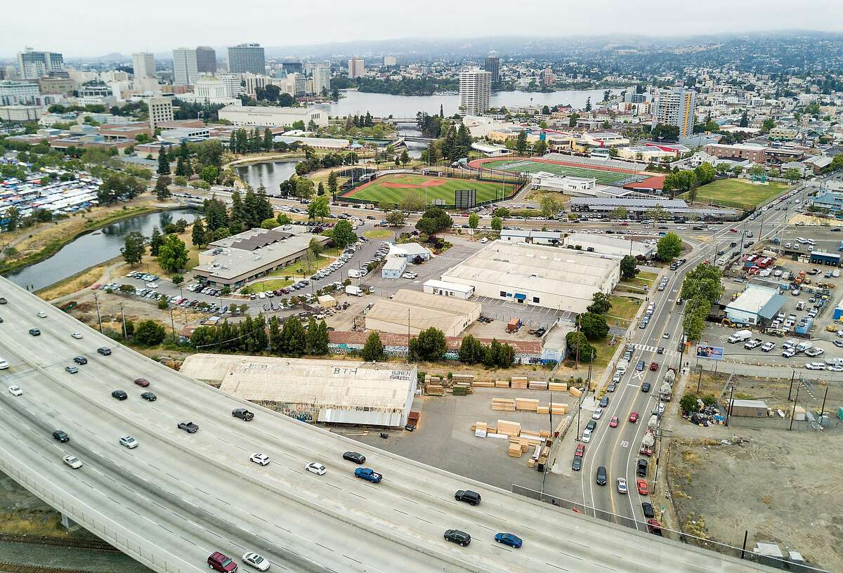 Traffic on I-880 passes the Peralta Community College District offices, one of the sites under consideration for a new Oakland Athletics stadium, on Sunday, May 28, 2017, in Oakland.