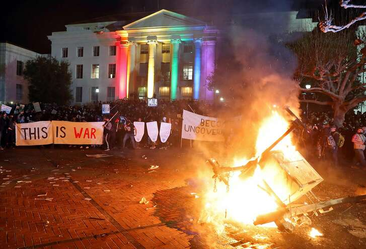A portable light unit burns after protesters forced the cancellation of a talk by right-wing provocateur Milo Yiannopoulos at UC Berkeley in Berkeley, Calif., on Wednesday, February 1, 2017.