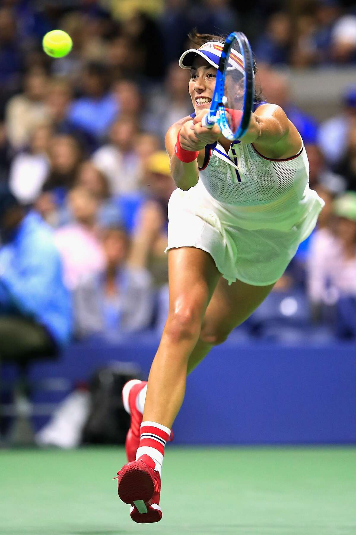 NEW YORK, NY - SEPTEMBER 03: Garbine Muguruza of Spain returns a shot during her women's singles fourth round match against Petra Kvitova of Czech Republic on Day Seven of the 2017 US Open at the USTA Billie Jean King National Tennis Center on September 3, 2017 in the Flushing neighborhood of the Queens borough of New York City. (Photo by Steven Ryan/Getty Images)