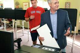 Assemblyman and county executive candidate Steven McLaughlin, right, and his son Dan, 21, cast their ballots for Rensselaer County executive Tuesday Sept. 12, 2017 in Troy, NY.  (John Carl D'Annibale / Times Union)